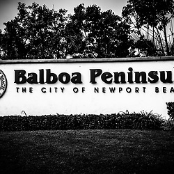 Balboa Peninsula sign for City of Newport Beach black and white picture. Balboa Peninsula is a neighborhood in Newport Beach in Orange County Southern California.