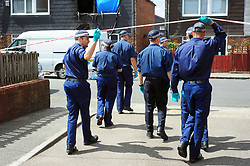 &copy; Licensed to London News Pictures. 08/08/2018<br /> Deptford, UK. A police search team outside a property where 7 year Joel Urhie was killed in a suspicious house fire at Adolphus Street, Deptford.  <br /> Photo credit: Grant Falvey/LNP
