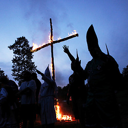 Kyle Green | The Roanoke Times<br /> 7/2/2011 Members of the Rebel Brigade KKK group in Martinsville, Virginia raise their hands a shout &quot;White Power&quot; during one of six cross burnings held on rural land in southwest Virginia. The KKK is making a comeback in the USA helped by high unemployment and a growing distrust in the government.