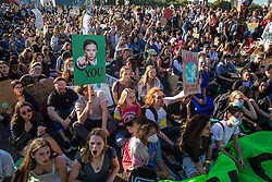 London, UK. 20 September, 2019. An image of Greta Thunberg is held aloft above students blocking Lambeth Bridge during the second Global Climate Strike in protest against a lack of urgent action by the UK Government to combat the global climate crisis. The Global Climate Strike grew out of the Fridays for Future movement and is organised in the UK by the UK Student Climate Network.