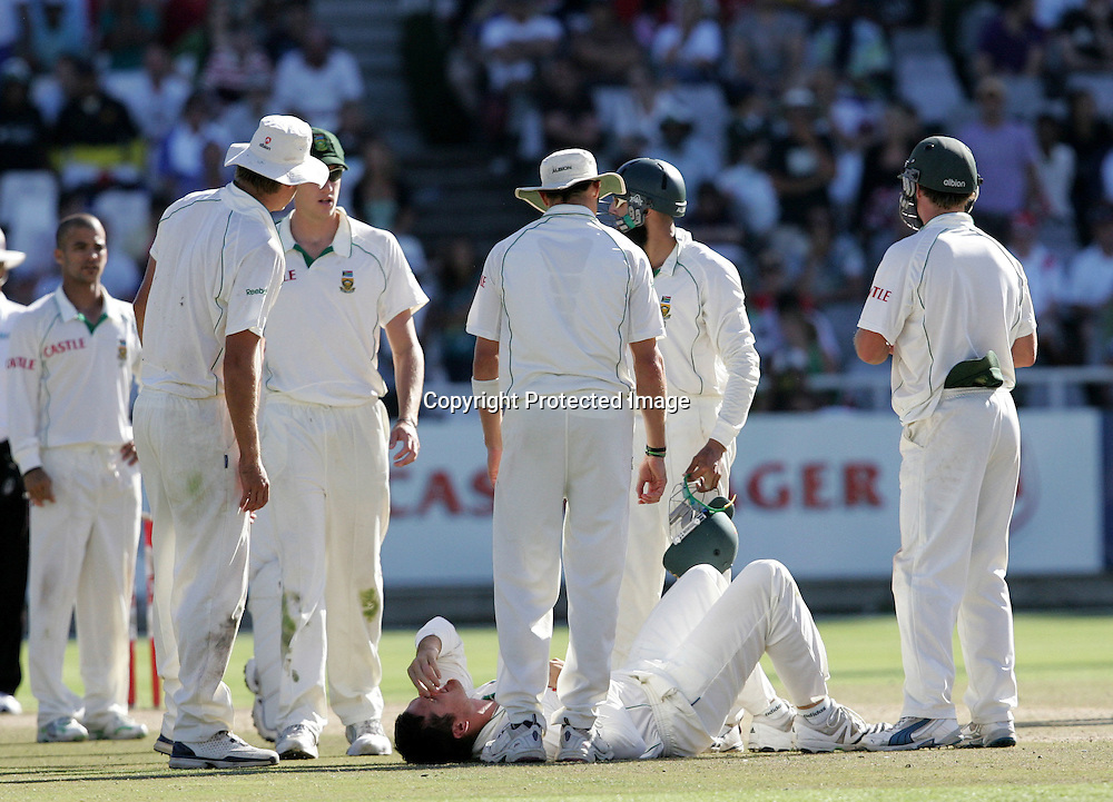 Graeme Smith lies injured after clashing with Paul Harris in the field during the 5th day of the third test match between South Africa and England held at Newlands Cricket Ground in Cape Town on the 7h January 2010.Photo by: Ron Gaunt/ SPORTZPICS