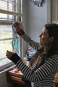 Kearny, New Jersey. November 19, 2013. Yadira Aleman holds a dreamcatcher her son Yolo made. Photo by Maya Rajamani/NYCity Photo Wire