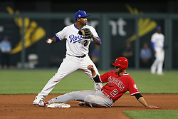 April 12, 2018 - Kansas City, MO, U.S. - KANSAS Kansas City, MO - APRIL 12: Kansas City Royals shortstop Alcides Escobar (2) can't turn the double play as Los Angeles Angels shortstop Andrelton Simmons (2) slides into second base in the ninth inning of an MLB game between the Los Angeles Angels of Anaheim and Kansas City Royals on April 12, 2018 at Kauffman Stadium in Kansas City, MO. The Angels won 7-1. (Photo by Scott Winters/Icon Sportswire) (Credit Image: © Scott Winters/Icon SMI via ZUMA Press)