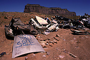 trashed cars in Utah desert