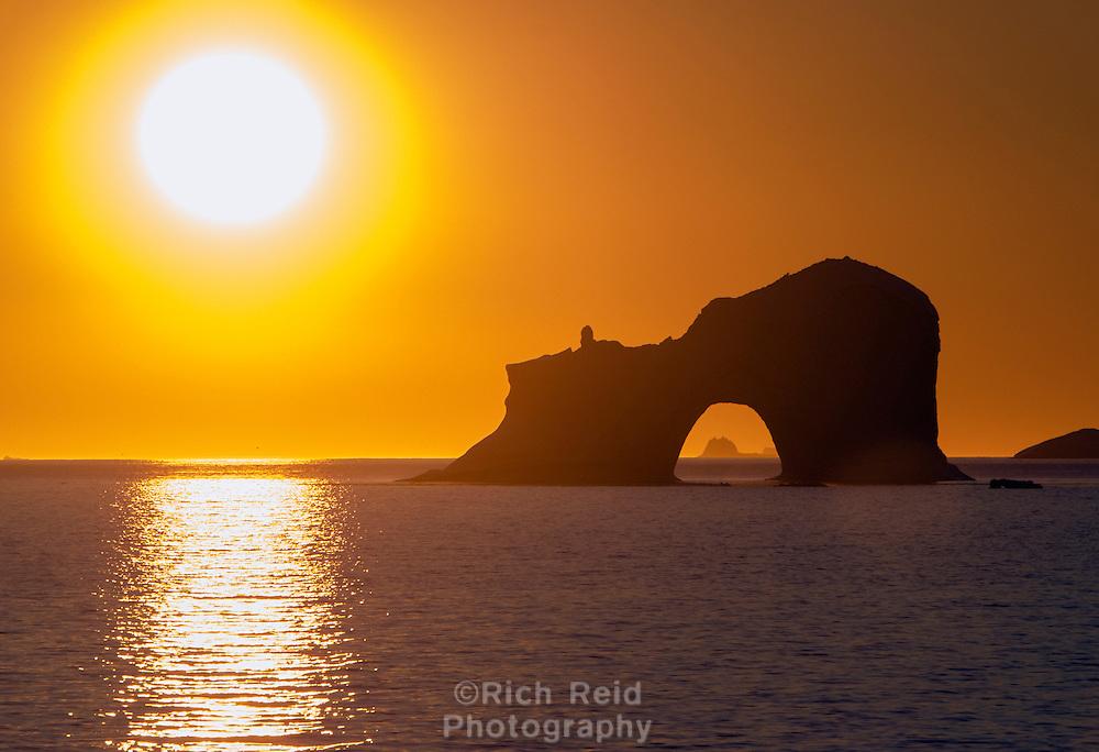 Iceberg with an arch in Umanak Fjord near Uummannaq, Greenland.