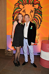ALEXANDER ARMSTRONG and his wife HANNAH at A Night of Reggae in aid of Save The Children held at The Roundhouse, Chalk Farm Road, London NW1 on 12th March 2014.