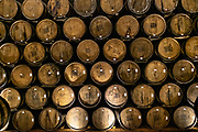 The barrel room inside the Casa Siete Leguas, El Centenario tequila distillery in Atotonilco de Alto, Jalisco, Mexico. The tequila is aged from 2-12 years in white oak barrels that once held American Kentucky Bourbon. The Seven Leagues tequila distillery is the oldest family owned distillery producing authentic handcrafted tequila using traditional methods.