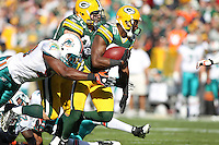 GREEN BAY, WI - OCTOBER 17: Greg Jennings #85 of the Green Bay Packers runs with the ball against the Miami Dolphins at Lambeau Field on October 17, 2010 in Green Bay, Wisconsin. The Dolphins defeated the Packers 23-20 in overtime. (Photo by Tom Hauck) Player:Greg Jennings