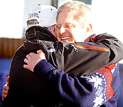 Friday, Feb 19, 2010; Andrew Weibrecht's Father Ed (right) and former coach Horswt Webber celebrate after Andrew's Bronze medal finish in the Olympic Super G event at the Lake Placid Friendship House in Whistler, BC, Canada during the 2010 Winter Olympic Games (Photo/Todd Bissonette).