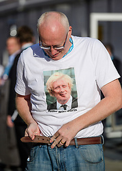 © Licensed to London News Pictures. 03/10/2017. Manchester, UK. A man wearing Boris Johnson T-shirt, tightening his belt on day three of the Conservative Party Conference. The four day event is expected to focus heavily on Brexit, with the British prime minister hoping to dampen rumours of a leadership challenge. Photo credit: Ben Cawthra/LNP