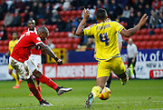 Charlton Athletic midfielder Callum Harriott lets fly from the edge of the box during the Sky Bet Championship match between Charlton Athletic and Nottingham Forest at The Valley, London, England on 2 January 2016. Photo by Andy Walter.