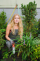 Portrait of a mid 20's woman while working in her small plant nursery