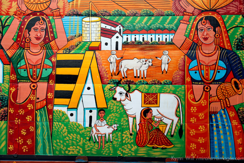 Asia, India, Jaipur. The wooden sides of a truck painted with a bright and colorful scene in India.