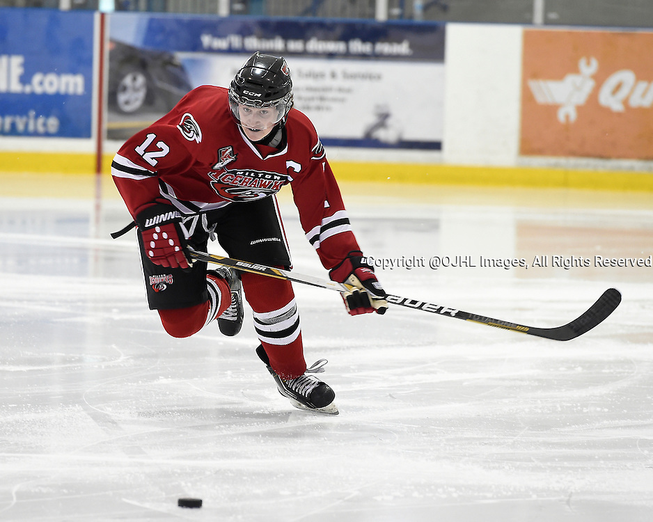 OAKVILLE, ON - Sep 27, 2014 : Ontario Junior Hockey League game action between Lindsay and Milton at the Govenors Showcase Tournament, Jake Baird #12 of the Milton Ice Hawks Hockey Club skates after the puck during the second period.<br /> (Photo by Andy Corneau / OJHL Images)