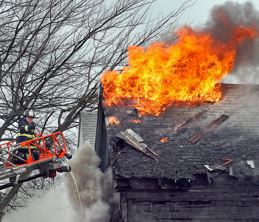 (01/05/10-Lynn,MA)  Firefighter seriously injured in this 2 alarm fire at 29 Oakwood Ave. Staff photo by Mark Garfinkel