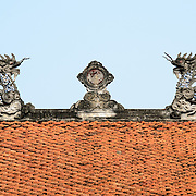The sculptured roof and tiles of one of the buildings at the Temple of Literature in Hanoi. The temple was built in 1070 and is one of several temples in Vietnam which are dedicated to Confucius, sages and scholars.