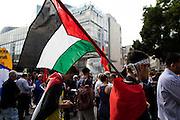 Frankfurt am Main | 24 July 2014<br /> <br /> Am Donnerstag (24.07.2014) demonstrierten etwa 150 Menschen aus linksradikalen und migrantischen Zusammenh&auml;ngen in Frankfurt am Main auf der Einkaufsstra&szlig;e Zeil gegen die israelischen Angriffe auf Pal&auml;stina und Gaza.<br /> Hier: Ein Teilnehmer der Kundgebung mit einer Pal&auml;stina-Flagge.<br /> <br /> Photo &copy; peter-juelich.com