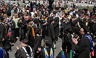 Middletown - Professors form two lines and applaud as graduates walk between the lines at the end of the 58th commencement at Orange County Community College on May 17, 2008.