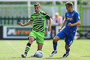 Forest Green Rovers Kevin Dawson(18) takes on Grimsby Town's Jake Hessenthaler(8) during the EFL Sky Bet League 2 match between Forest Green Rovers and Grimsby Town FC at the New Lawn, Forest Green, United Kingdom on 17 August 2019.