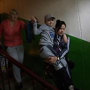 Natasha says goodbye to her grandmother before she returns to Kiev, where Kirill will undergo further surgeries.