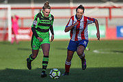 Forest Green Rovers Issy Newns(9)takes on Cheltenham Town's Sam Morris during the Gloucestershire FA Trophy match between Cheltenham Town Ladies FC and Forest Green Rovers Ladies FC at LCI Rail Stadium, Cheltenham, England on 19 November 2017. Photo by Shane Healey.