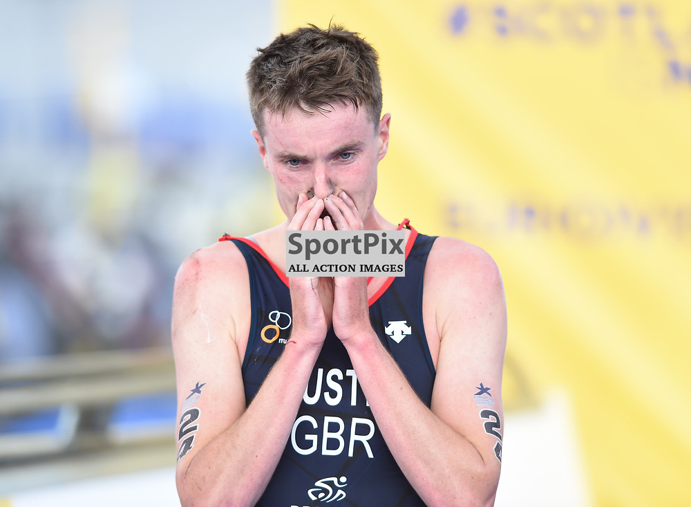 Great Britain's Marc Austin carries on and finishes race after colliding with a referee in the Men's Elite Standard Race, ETU Triathlon,  European Championships, Strathclyde Park, Motherwell Scotland, Friday 10 August 2018, (c) Angie Isac | SportPix.org.uk