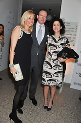 Left to right, NADJA SWAROVSKI, RUPERT ADAMS and MOLLIE DENT-BROCKLEHURST at the Swarovski Whitechapel Gallery Art Plus Fashion fundraising gala in support of the gallery's education fund held at The Whitechapel Gallery, 77-82 Whitechapel High Street, London E1 on 14th March 2013