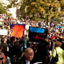 """Washington, DC, October 30, 2010 - Jon Stewert and Steven Colbert host the Rally To Restore Sanity and/or Fear.  Tens of thousands of ralliers donned costumes and carried signs. """"THIS IS A SIGN OF FEAR"""""""