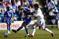 Photo: Olly Greenwood.<br />Gillingham v Huddersfield Town. Coca Cola League 1. 08/04/2006. Gillingham's Alan Pouton and Huddersfield's Mark Hudson battle.