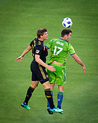 Los Angeles FC defender Walker Zimmerman (25) defends against Seattle Sounders defender Will Bruin (17) during a MLS soccer match in the inaugural game at Banc of California Stadium in Los Angeles, Sunday, April 29, 2018. LAFC defeated the Sounders 1-0. (Eddie Ruvalcaba/mage of Sport)