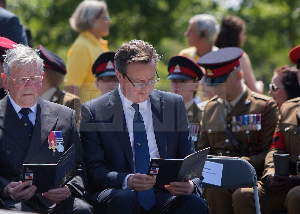 © Licensed to London News Pictures. 10/06/2015. Alrewas, UK.  Prime Minister David Cameron attended a Service of Dedication to inaugurate the Bastion Memorial, for those who lost their lives during combat operations in Afghanistan.  Over 2000 guests attended the ceremony.   Photo credit : Alison Baskerville/LNP