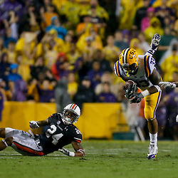 Sep 21, 2013; Baton Rouge, LA, USA; LSU Tigers running back Jeremy Hill (33) leaps over Auburn Tigers defensive back Ryan Smith (24) as defensive back Robenson Therezie (27) comes in for the tackle during a game at Tiger Stadium. Mandatory Credit: Derick E. Hingle-USA TODAY Sports