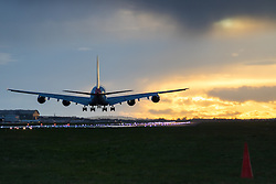 Heathrow Airport, London, March 28th 2016. An Airbus A380 lands on runway 27R as the sun sets at London Heathrow.<br /> &copy;Paul Davey