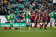 4th November 2017, Easter Road, Edinburgh, Scotland; Scottish Premiership football, Hibernian versus Dundee; Dundee's Jack Hendry on floor after clash with Hibernian's Anthony Stokes