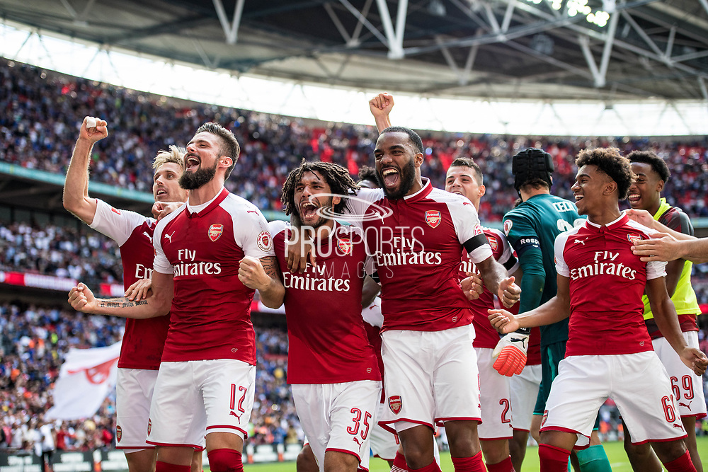 Arsenal forward Olivier Giroud (12), Arsenal midfielder Mohamed Elneny (35), Arsenal forward Lacazette (9) celebrate win  during the FA Community Shield match between Arsenal and Chelsea at Wembley Stadium, London, England on 6 August 2017. Photo by Sebastian Frej.