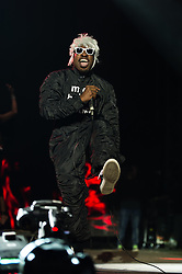 "© Licensed to London News Pictures. 05/09/2014. Isle of Wight, UK. Outkast performing live at Bestival 2014 Day 2 Friday.  In this picture - André ""André 3000"" Benjamin.  Outkast are a hip hop duo consisting of rappers André ""André 3000"" Benjamin and Antwan ""Big Boi"" Patton.  This weekend's headliners include Chic featuring Nile Rodgers, Foals and Outcast.   Bestival is a four-day music festival held at the Robin Hill country park on the Isle of Wight, England. It has been held annually in late summer since 2004.    Photo credit : Richard Isaac/LNP"