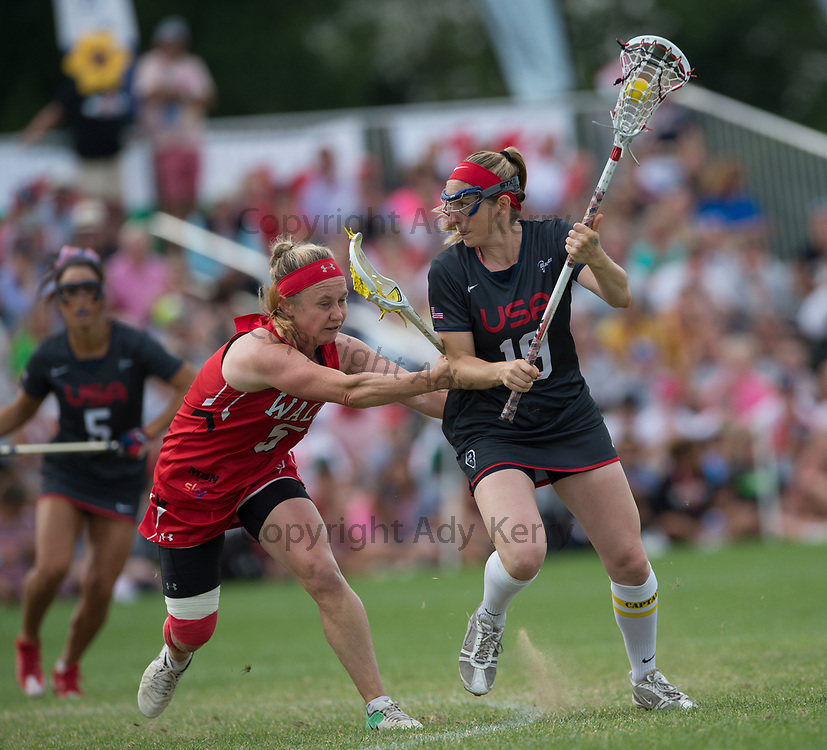 USA's Sarah Bullard  challenges with Wales' Charlotte Williams at the 2017 FIL Rathbones Women's Lacrosse World Cup, at Surrey Sports Park, Guildford, Surrey, UK, 18th July 2017.