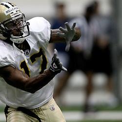 August 5, 2011; Metairie, LA, USA; New Orleans Saints wide receiver Robert Meachem (17) during training camp practice at the New Orleans Saints practice facility. Mandatory Credit: Derick E. Hingle