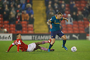 Jordan Williams of Barnsley F.C. challenges Kamil Grosicki of Hull City during the EFL Sky Bet Championship match between Barnsley and Hull City at Oakwell, Barnsley, England on 30 November 2019.