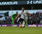 Tottenham Hotspur striker Harry Kane scoring penalty 4-1 during the Barclays Premier League match between Tottenham Hotspur and Sunderland at White Hart Lane, London, England on 16 January 2016. Photo by Matthew Redman.