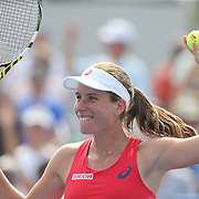 Johanna Konta, Great Britain, hits signed balls into the crowd after her victory over Garbine Muguruza, Spain, in the Women's SIngles second round match during the US Open Tennis Tournament, Flushing, New York, USA. 3rd September 2015. Photo Tim Clayton