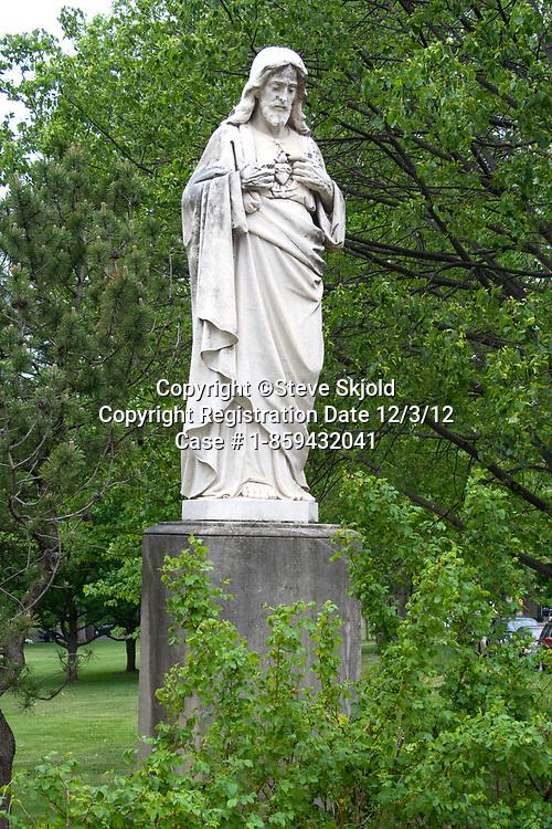 Sacred heart of Jesus statue on the campus of St Catherine's University.  St Paul Minnesota MN USA