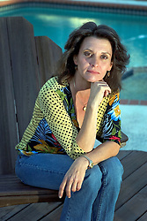 17th November, 2005. Mandeville, Louisiana. <br /> Blue Marlin attack survivor. Denise Le Blanc, glamorous mother and grand mother poses at her home in Mandeville, Louisiana. In the fall of 2000 Denise survived an horrific attack from a fish! A blue marlin leapt from the waters off the Panamanian coast where she was sport fishing and punctured her chest, through her silicone breast implant all the way through to her back. Denise and her doctors have credited her breast implant with saving her life. <br /> Photo; Charlie Varley<br /> varleypix.com