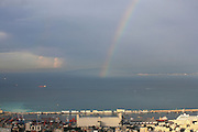 Israel, Haifa. View of Haifa port, Haifa bay and downtown. Rainbow over the bay ..