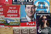 Nederland, Nijmegen, 10-3-2017 Verkiezingsbord met affiches voor de komende verkiezingen voor de tweede kamer. Jezusleeft.nl, jezus,regeren, pvda, sp, asscher, piratenpartij, forum voor democratie, d66,cda, Marianne Thieme .Netherlands, election board with posters for the forthcoming national elections. Foto: Flip Franssen