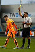 Colchester FC Midfielder Joe Edwards picks up the first yellow of the game during the Sky Bet League 1 match between Millwall and Colchester United at The Den, London, England on 21 November 2015. Photo by Andy Walter.