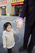 ZHENGZHOU, CHINA - FEBRUARY 17: (CHINA OUT)<br /> <br />  Aisa's Tallest Man Comes To Zhengzhou in China<br /> <br /> A girl holds Zhang Huan's finger in street on February 17, 2016 in Zhengzhou, Henan Province of China. Zhang Huan was 2.38 meters tall and known to be the tallest man in Asia.<br /> ©Exclusivepix Media