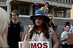 Activist Mike Hisey is seen in discussion with a bystander as protestors demand the removal of the Frank Rizzo statue, at a rally near City Hall, in Philadelphia, PA, on August 21, 2017.