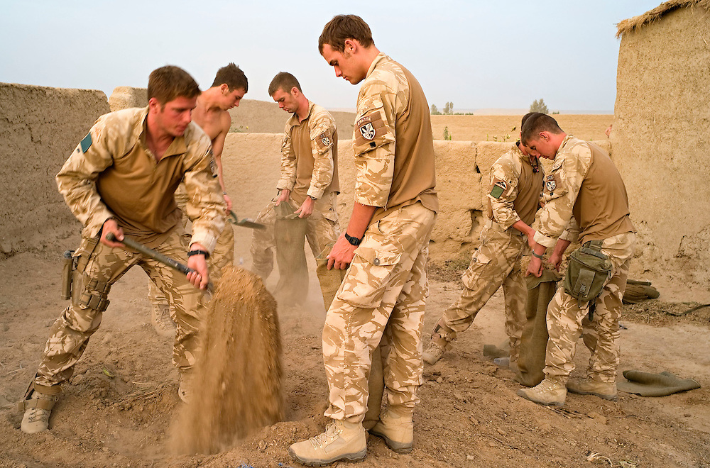 British soldiers of 3rd Battalion The Parachute Regiment fill sand bags to fortify their temporary patrol base after an airborne assault as part of Operation 'Southern Beast'. Kandahar Province, Afghanistan on the 4th of August 2008.