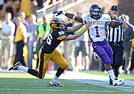 September 15 2012: Iowa Hawkeyes kicker Mike Meyer (96) knocks Northern Iowa Panthers running back Carlos Anderson (1) out of bounds after a kick during the second half of the NCAA football game between the Northern Iowa Panthers and the Iowa Hawkeyes at Kinnick Stadium in Iowa City, Iowa on Saturday September 15, 2012. Iowa defeated Northern Iowa 27-16.